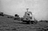 Lunar Module (LM) simulator and various Astrogeology support vehicles located on the south side of Meteor Crater during AAP Test 2; 16-18 November 1965; USGS photo F11651.USGS Open-File Report 2005-1190, Figure 035.