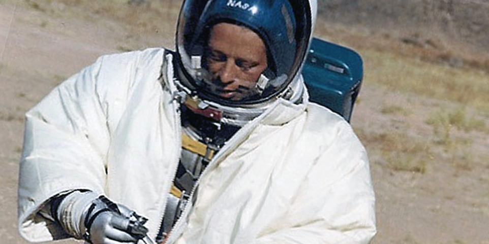 Gordon Swann in Apollo space suit with thermal outer garment
