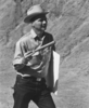 Shoemaker lecturing to astronaut group on rim crest of Meteor Crater during field trip 16-19 May 1967; photo from Astrogeology website