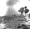 Dave Roddy with George Herman of CBS being filmed at rim of Meteor Crater; USGS photo P862PR, F769221 (from OFR 2005-1190.