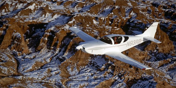 "Ray Batson ""in the office"" after retirement from the USGS—the cockpit of the  Sudden Snowflake, Glasair III N93RB, over the Echo Cliffs, Arizona.  Photo by Rhoda Batson."