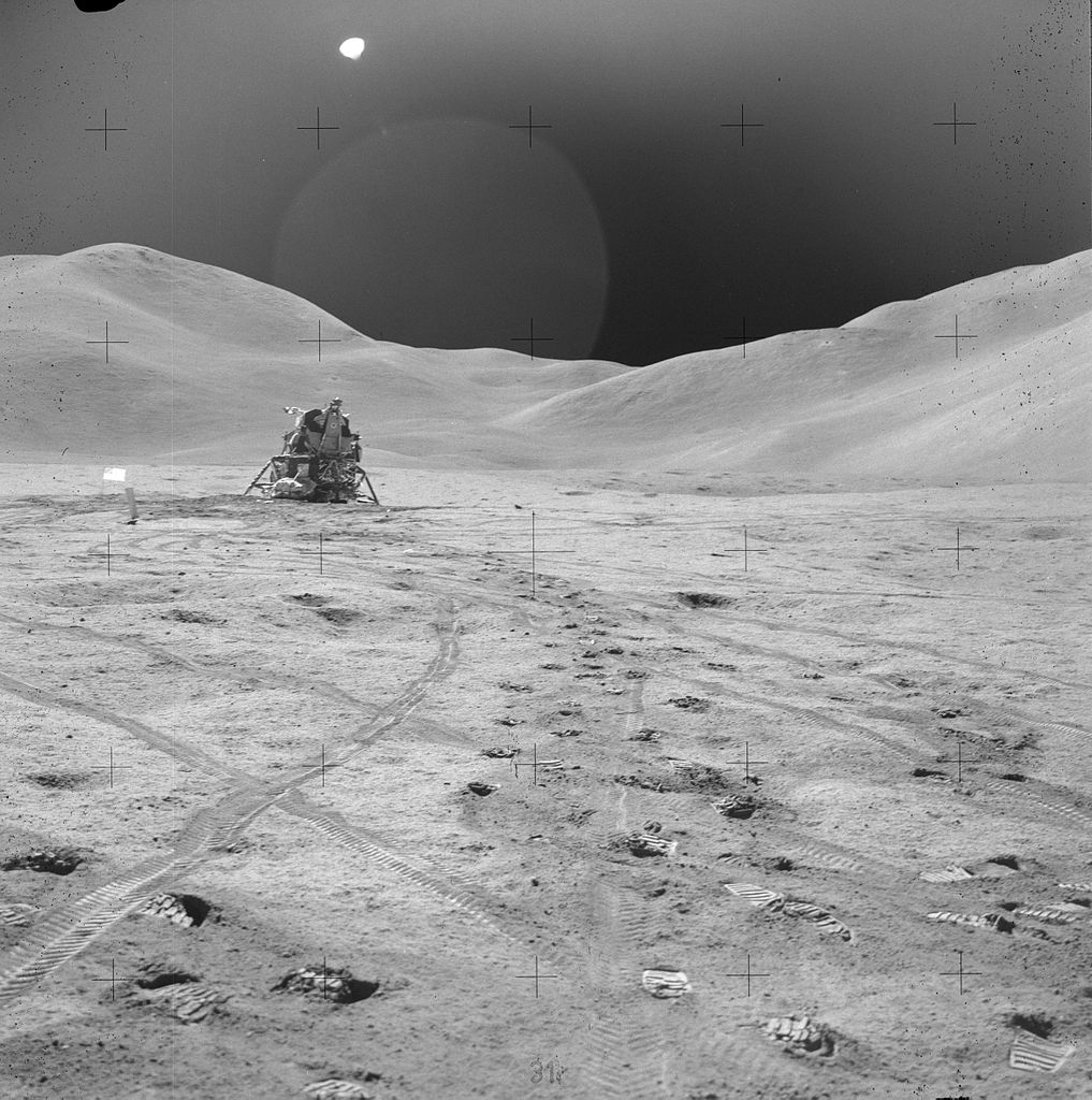 "Apollo 15 Lunar Module near Hadley Rille, with the ""Swann Range"" of the  Montes Apenninus in the background"